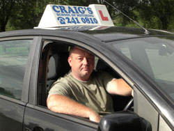 Driving Instructor with his Car